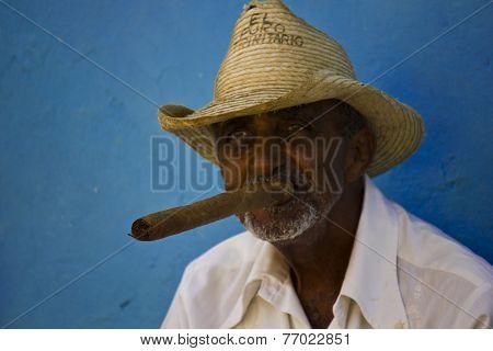 Old Man Smoking a huge Cigar.