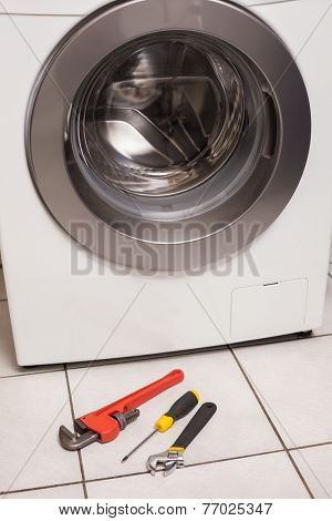 Washing machine with tools in the kitchen