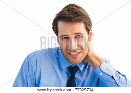 Businessman having a sore neck on white background