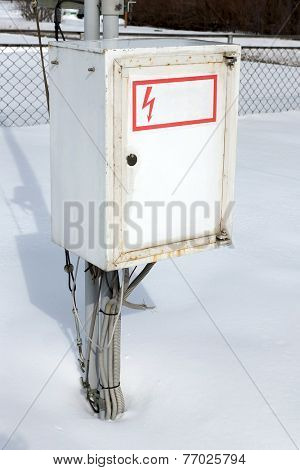Metal electric box in the winter.