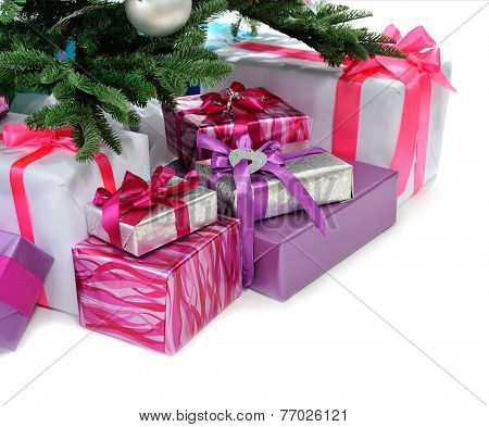 heap of  gifts under Christmas tree isolated on  white