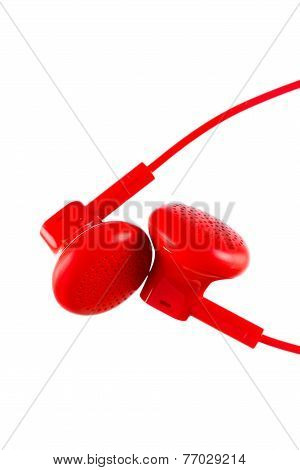 Close Up On Red Earbuds Isolated On White Background