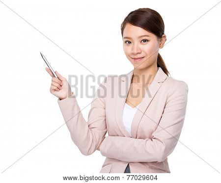 Businesswoman with pen point up