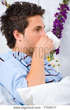 Profile Of Man Drinking Coffee