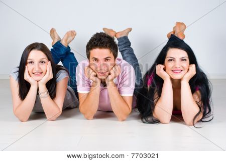 Group Of Friends In A Row Lying  On Floor