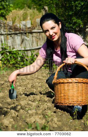 Happy Woman Working In Garden