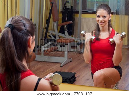 Young Girl Exercising With Dumbbells At Home
