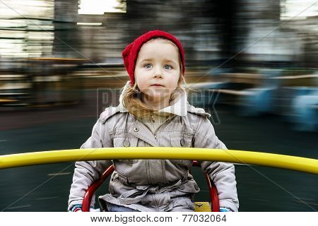 Cute Little Girl Rounding On Merry-go-round