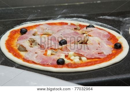 oven ready pizza with bacon and olive