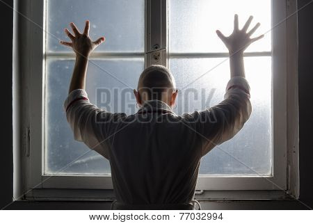 Bald Woman Suffering From Cancer Leaning On The Hospital Window