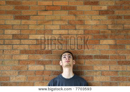 Young Man Looks Up Above