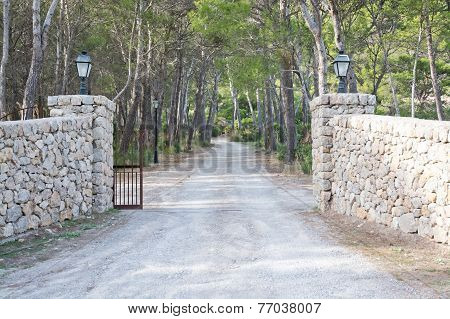 Dry stone gates by luxurious estate