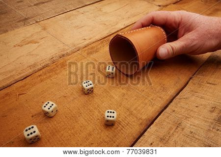Hand Holds The Dice Cup