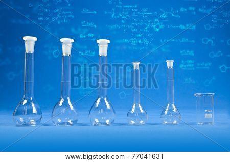 Chemistry Science - Flasks On Blue Background