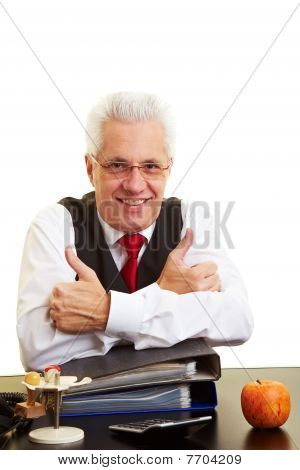 Businessman Holding Thumbs Up