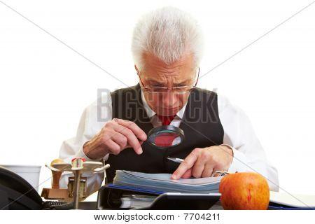 Man Reading Fine Print