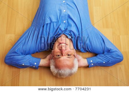 Man Laying Relaxed On His Back