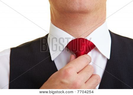 Man Checking His Tie Knot