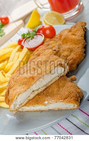 Schnitzel With French Fries And A Spicy Dip