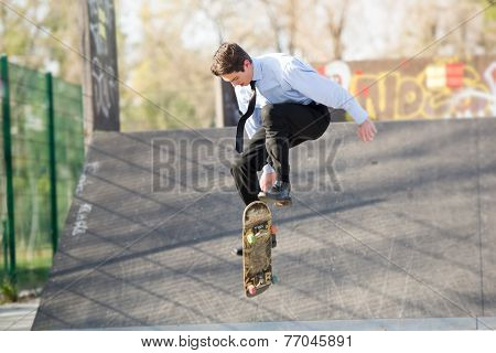 Businessman In The Jump With Skateboard