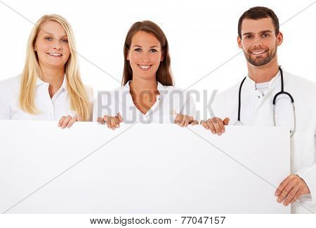 Group of young medical professionals standing behind placeholder. All on white background.