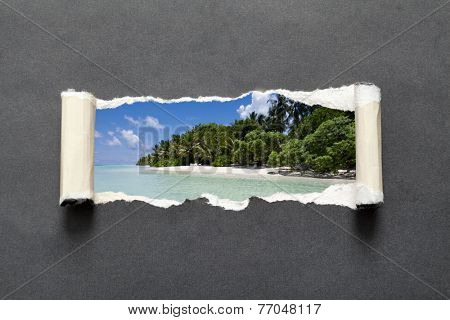 Torn black paper edge with untouched tropical beach in the Indian ocean