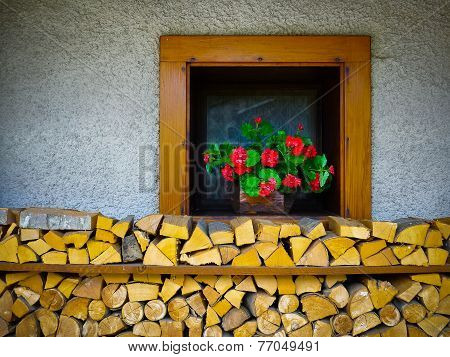 Window And Chopped Wood