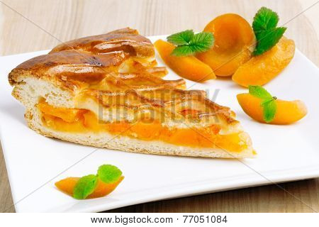 Apricot pie on a plate
