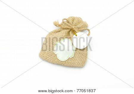 Hessian sack tied with string and white tag, isolated