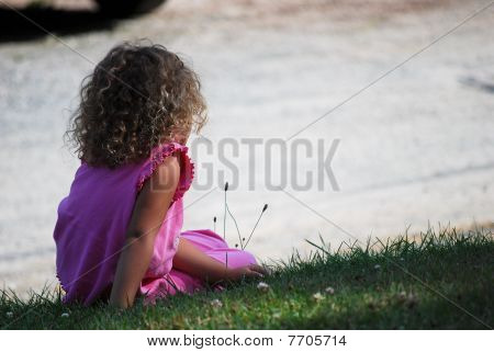 Girl Sitting on Lawn