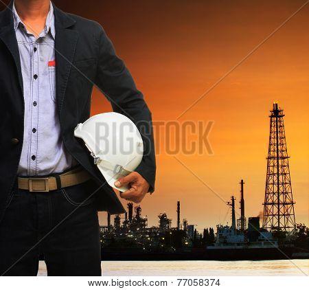 Engineering Man And Safety Helmet Standing Against Beautiful Dusky Sky Of Oil Refinery Plant Scene U