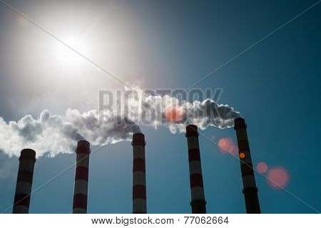 A Row Of Power Plant Chimney