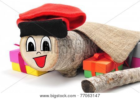a Tio de Nadal, a typical Christmas character of Catalonia, Spain, made by myself, surrounded by some gifts on a white background