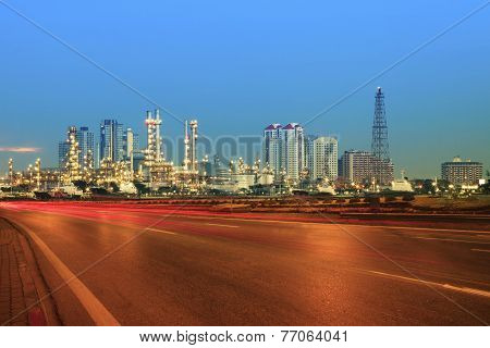 Beautiful City Scape Of Road And Land Transportaiton Against Lighting Of Oil Refinery Industry Plant
