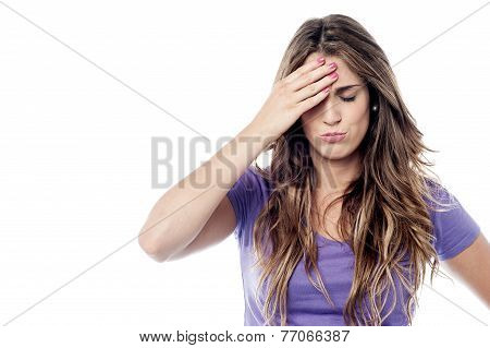 Tensed Woman Touching Her Head
