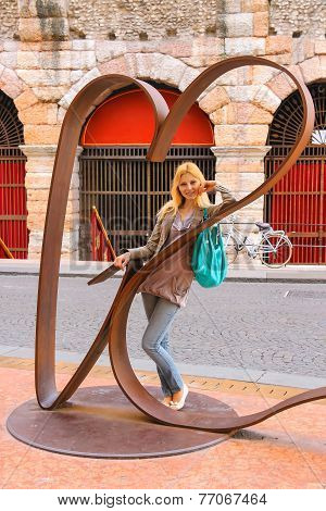 Attractive Girl Near Sculptural Composition