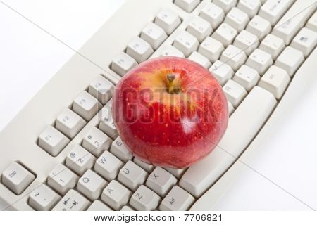 Computer Keyboard And Red Apple
