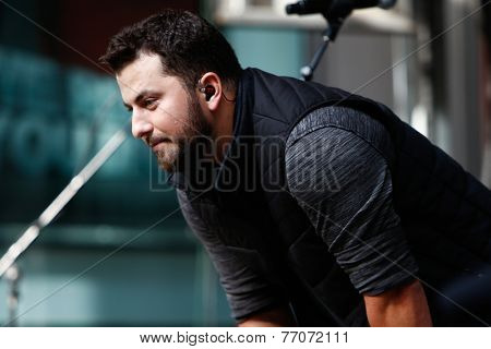 NEW YORK-AUG 22: Country music singer Tyler Farr performs at Fox and Friends' All-American Summer Concert Series on the corner of 48th Street and 6th Avenue on August 22, 2014 in New York City.