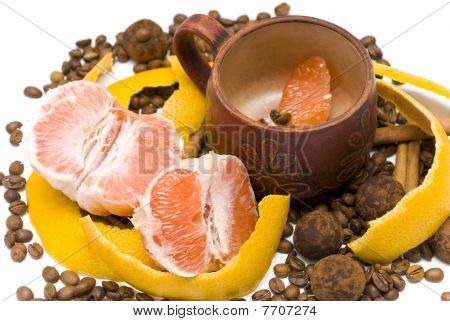 Peeled Grapefruit And A Cup