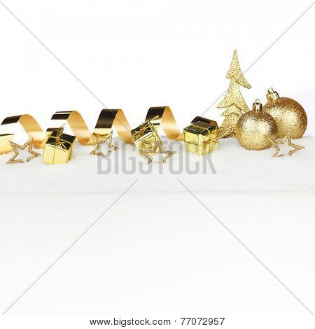 Christmas card with decorative golden baubles on snow