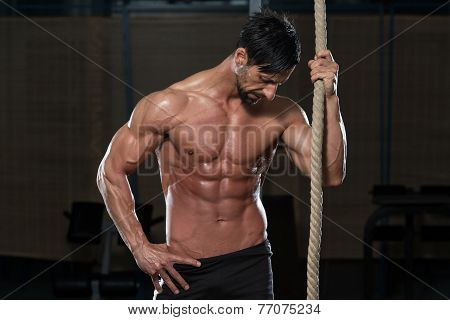 Fitness Athlete Resting After Performing A Rope Climbing