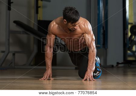 Strong Muscular Men Kneeling On The Floor