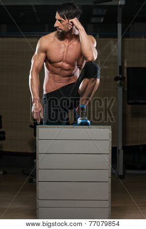 Man Resting After Performing A Box Jump