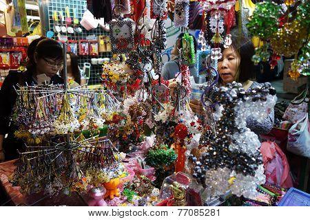 A Vendor Sells Handphone Beads Jewelry In Mong Kok, Hong Kong