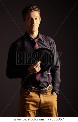 Portrait of an imposing young man in elegant clothes. Men's beauty, fashion.
