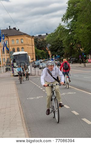 Bicyclists On Nice Bikes In Central Stockholm