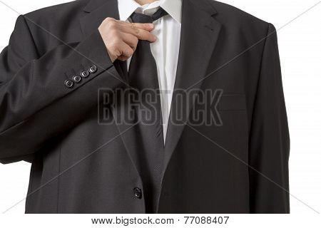 Man In Siut Straightening His Tie