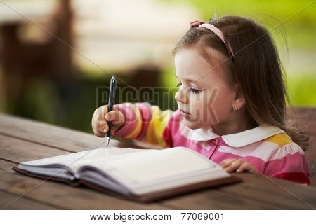 cute little girl learning to write