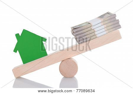 Green House Model And Dollar Bundles Balancing On Seesaw