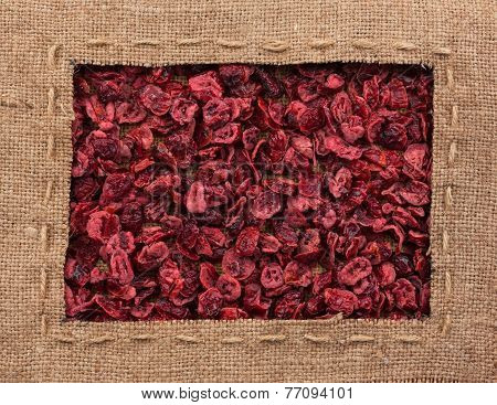 Frame Made Of Burlap With The Line Lies On Dried Cranberries